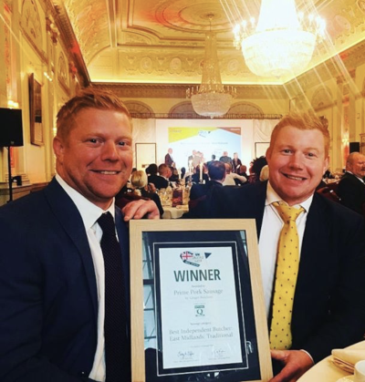 Tom and Ed Armstrong with their Best Pork Sausage in the East Midlands winners plaque at British Sausage Awards 2018